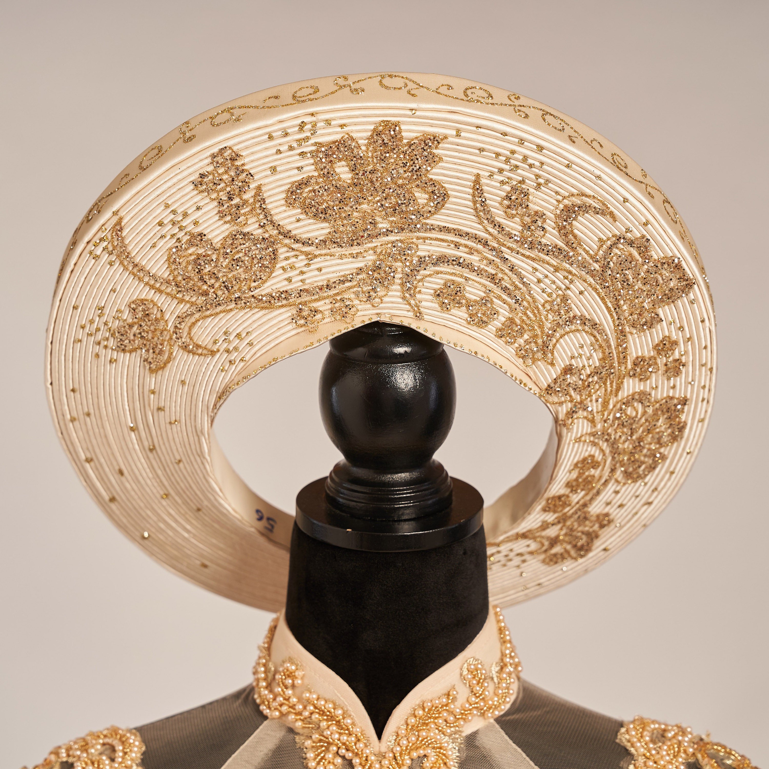 An elaborate headpiece with gold details