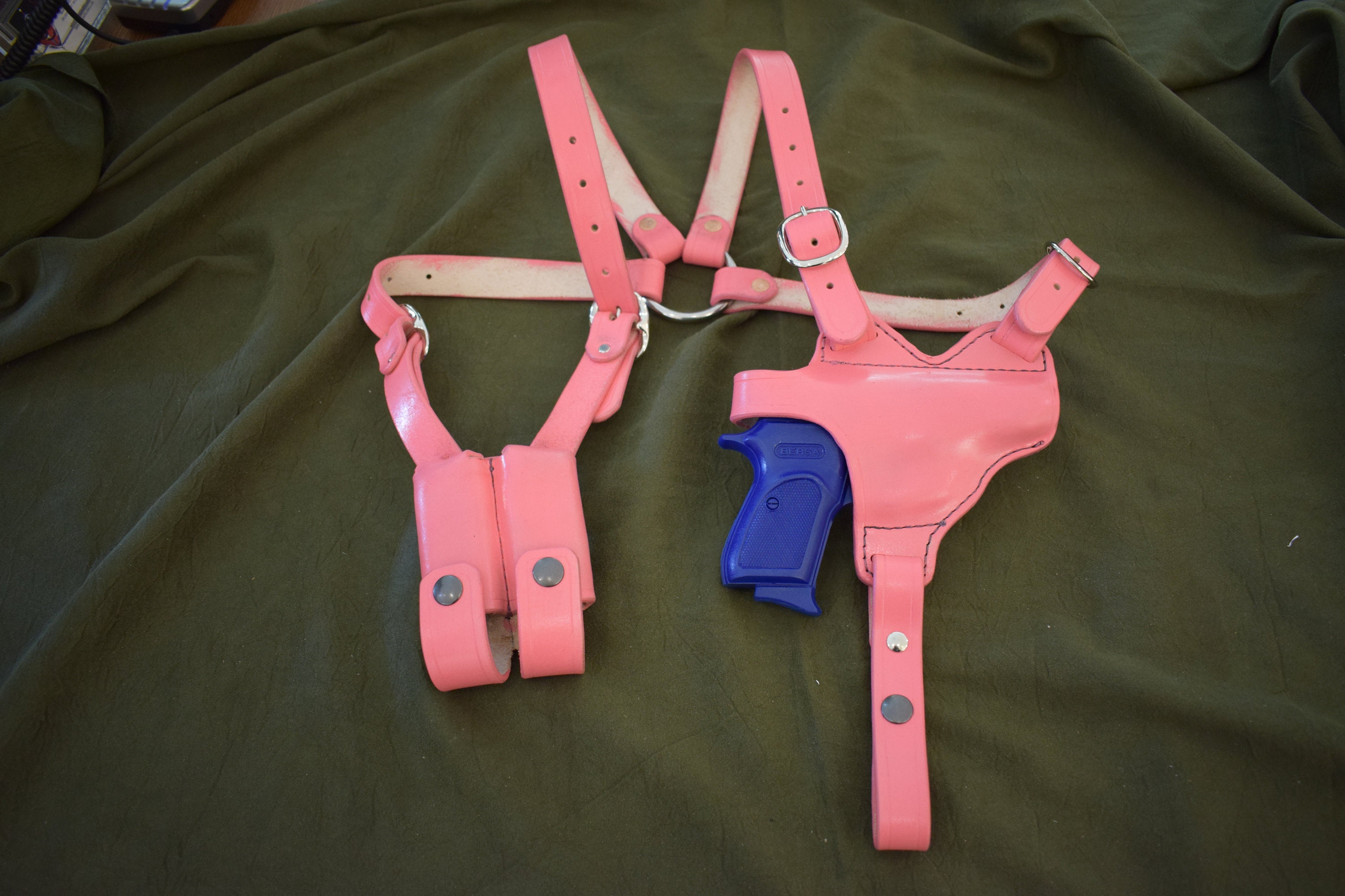 A hot pink leather shoulder holster