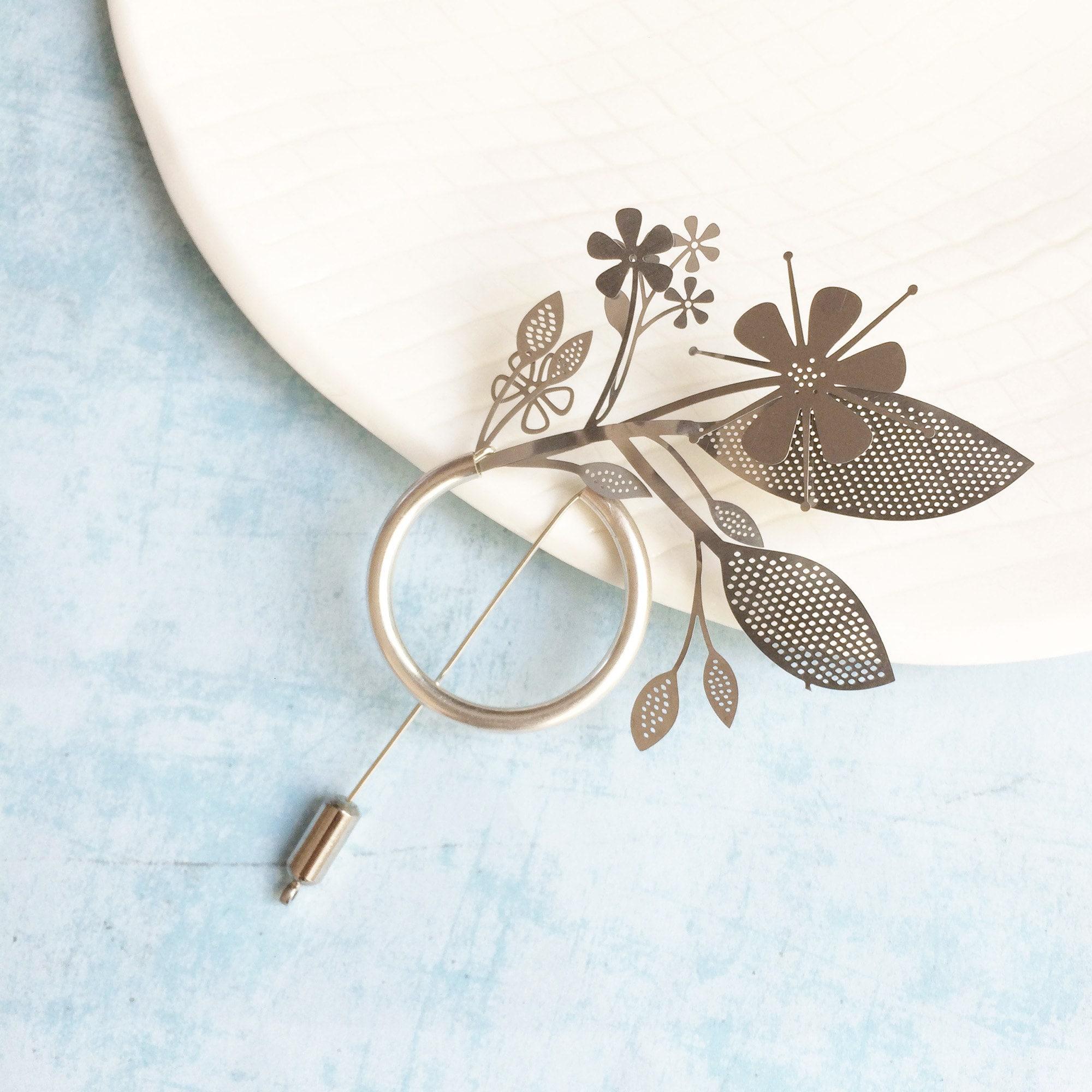 Floral steel brooch