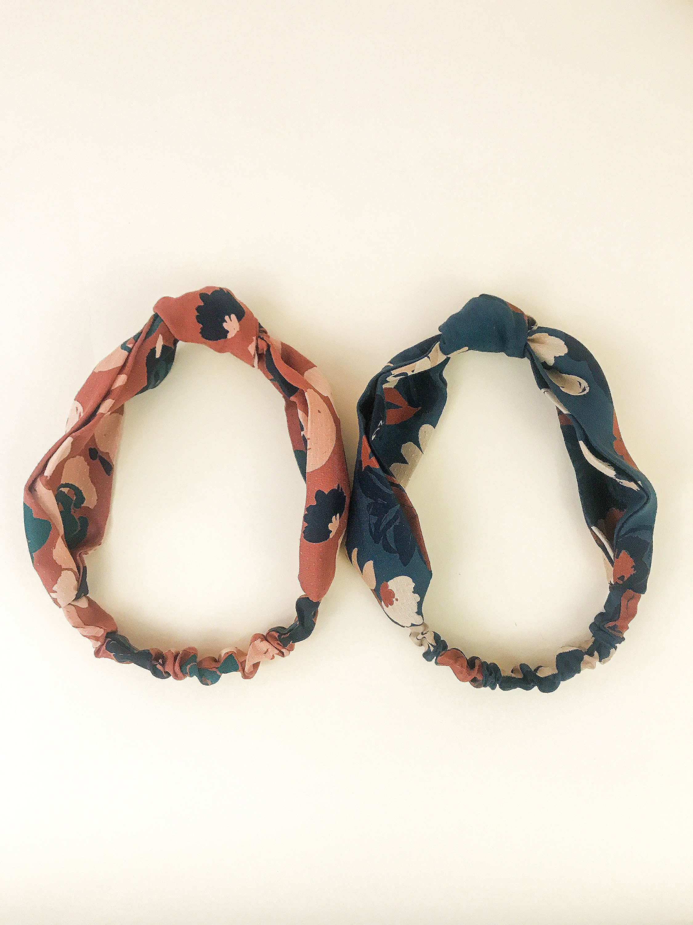 Brown and gray floral knotted headbands.