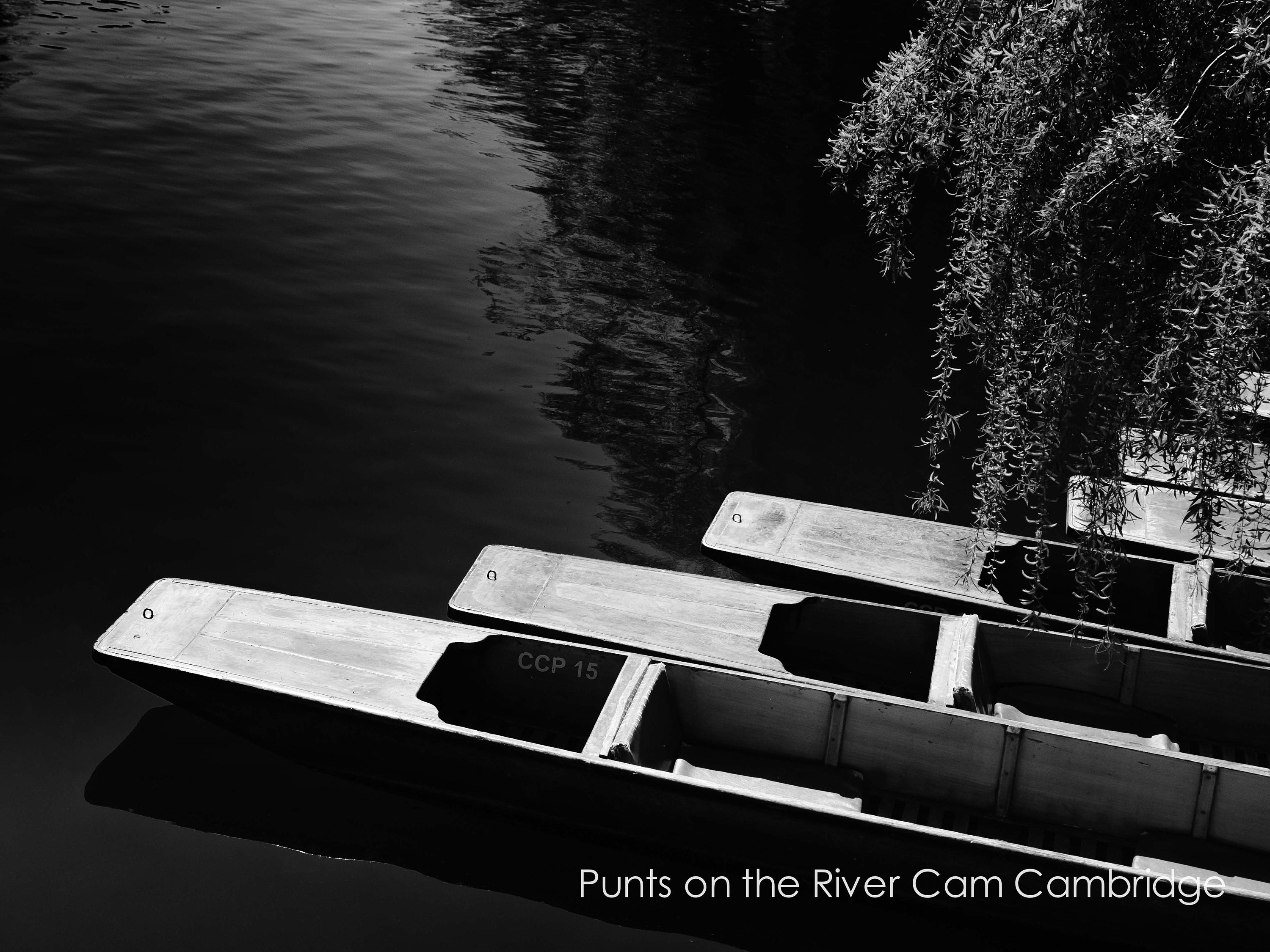 black and white limited edition print of empty punts on the river cam in Cambridge in custom sizes and finishes like art panel and canvas