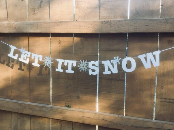Let it Snow banner in white glitter with silver glitter snowflakes
