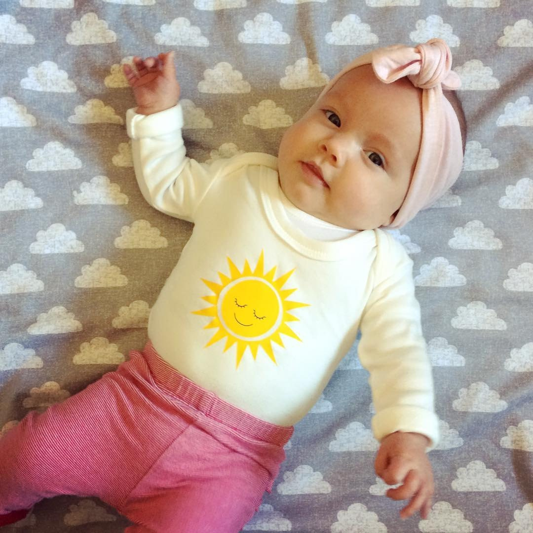 Lottie Piia wearing Mini Suzie London Happy Sun babygrow