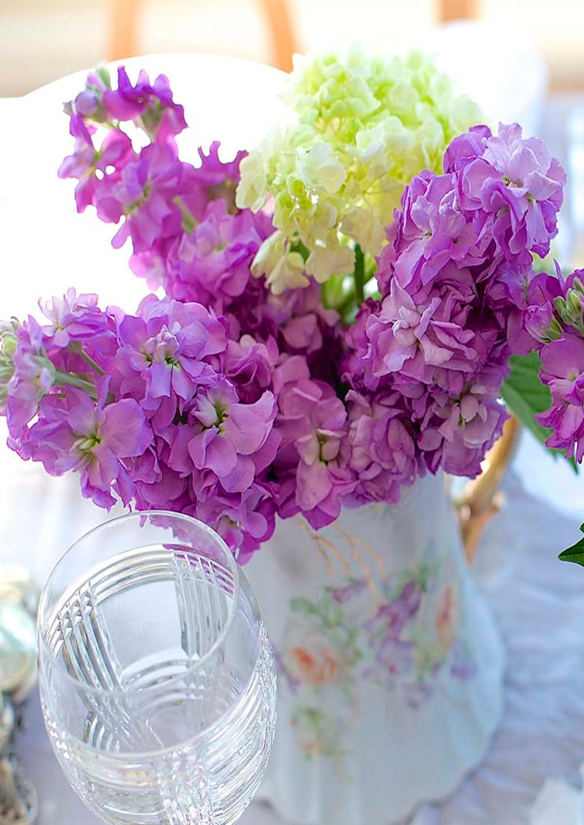 Flowers chosen to match the colors in your favorite china pieces set in a lovely vintage or antique pitcher adds a true summertime feel.