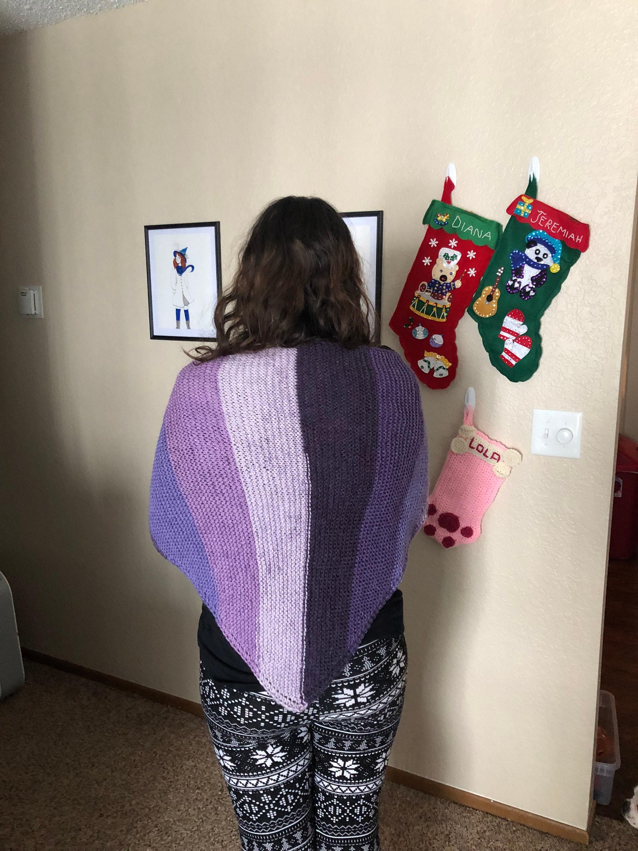 Woman wearing purple knit shawl