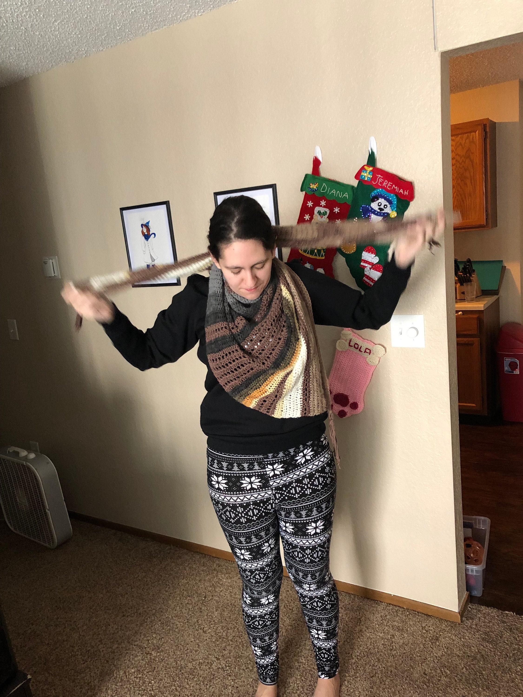 Woman wearing crochet scarf