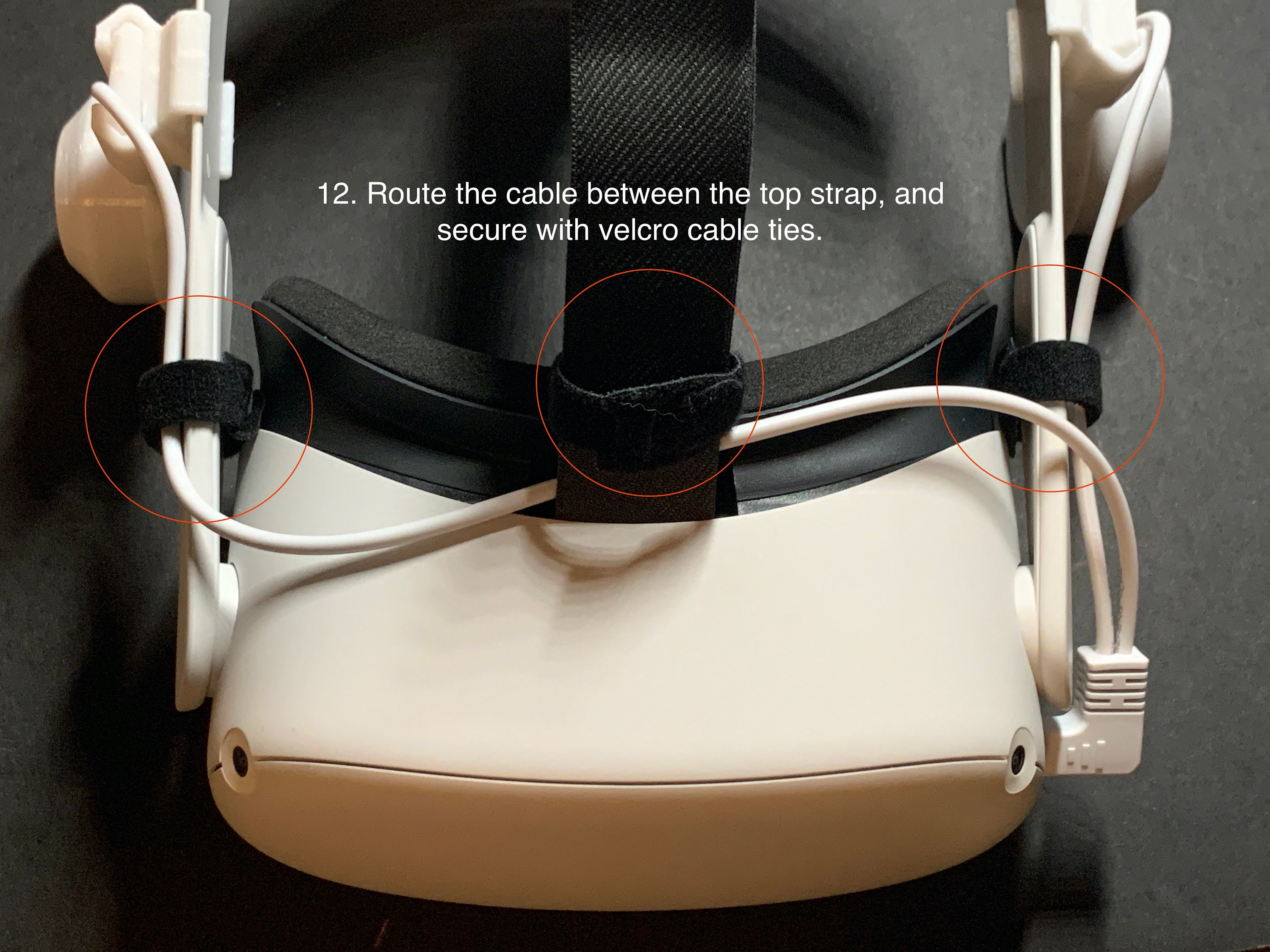 12. Route the cable between the top strap, and secure with velcro cable ties.
