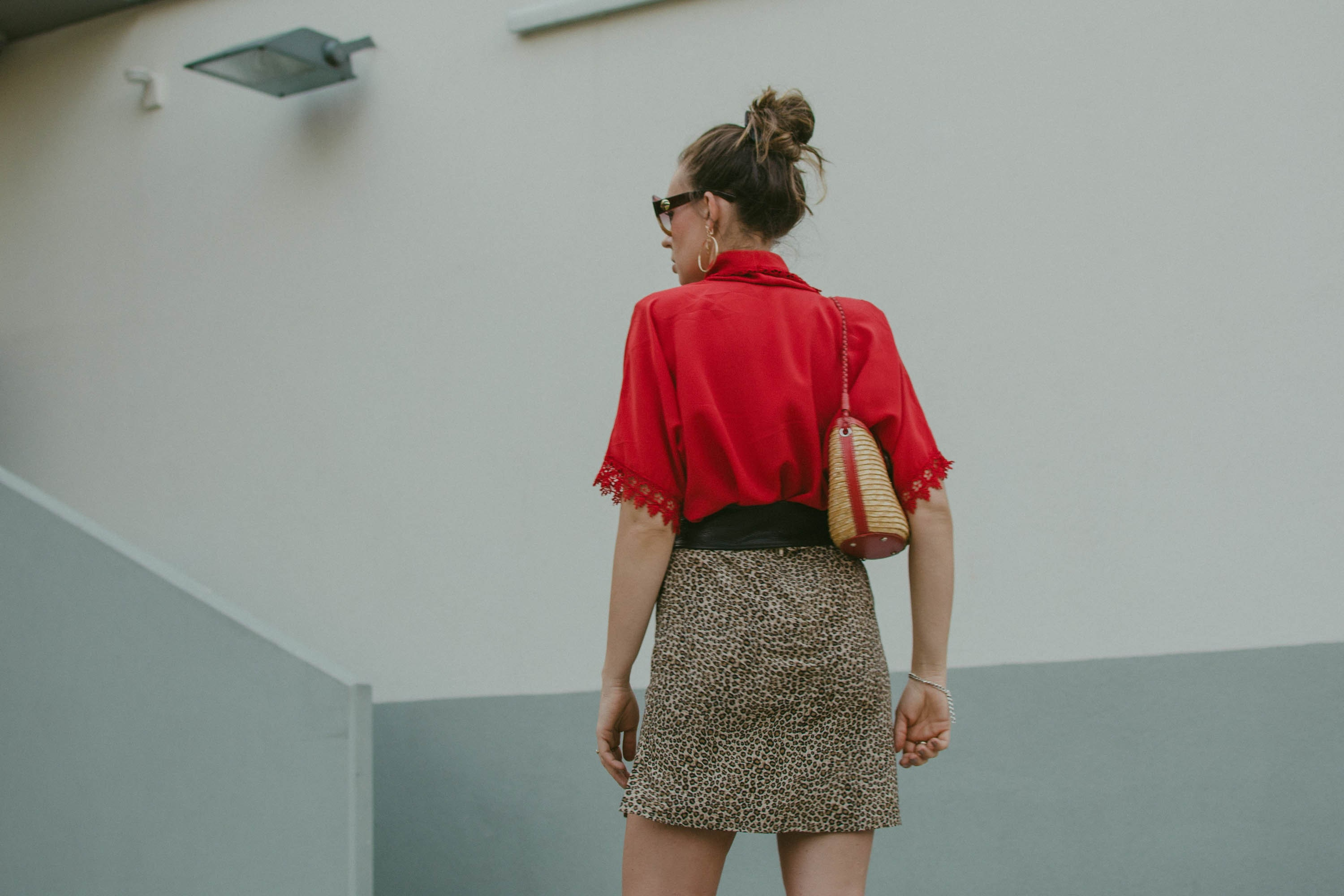 red blouse and leopard mini skirt