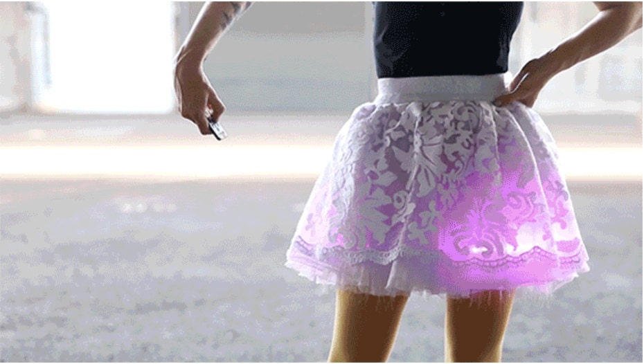 Girl with remote controlled glowing skirt
