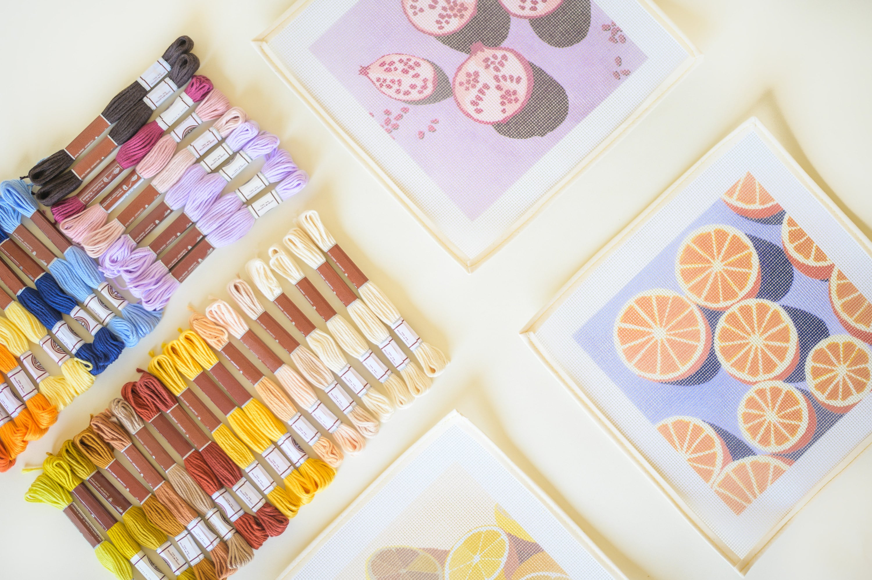 Pomegranates, Oranges and Lemons needlepoint kits from Unwind Studio designed by Laura Croft, Ana Popescu and Anca Putin with a colourful range of soft cotton threads.