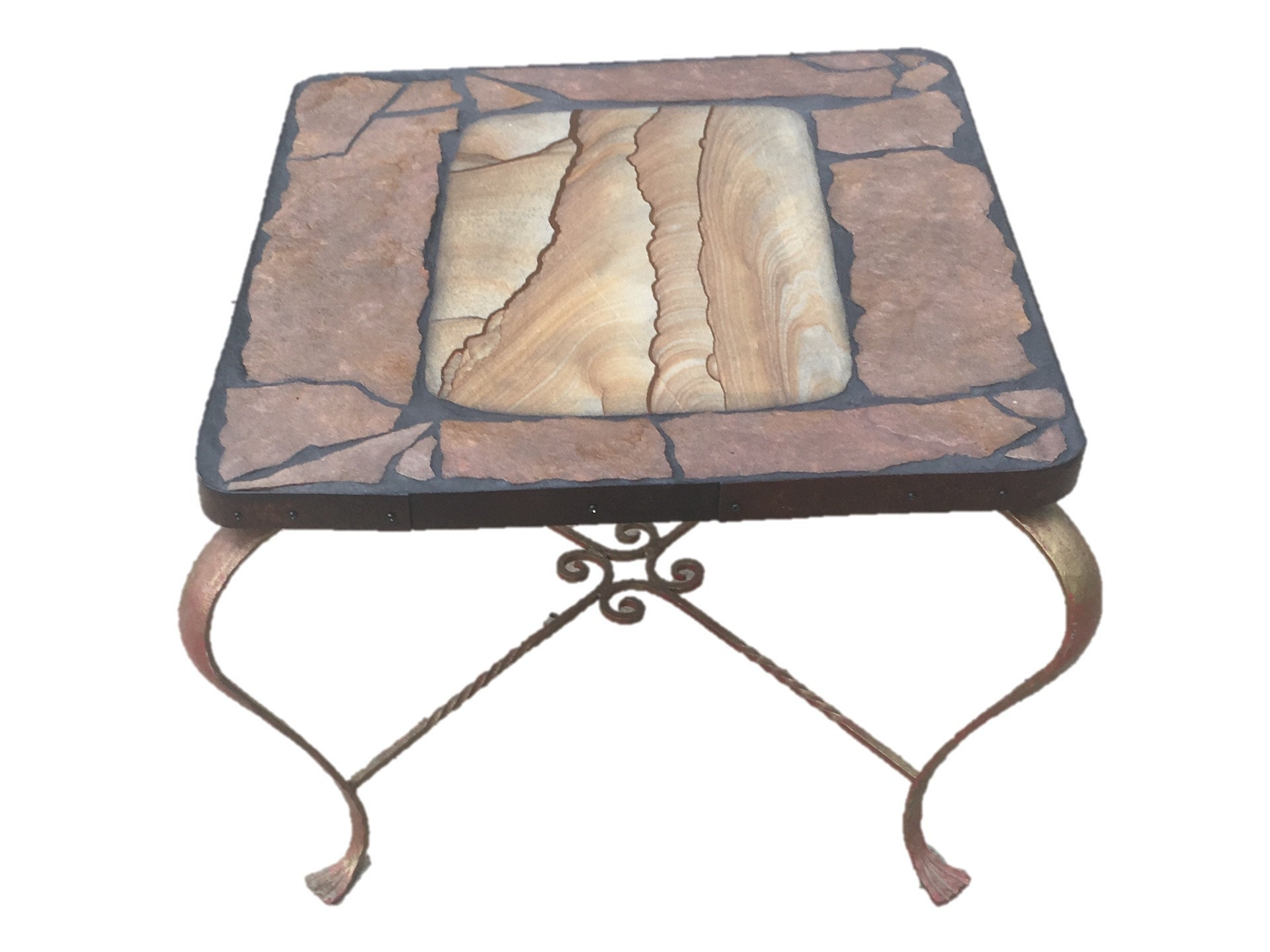 Jims Table: A natural stone toped table featuring a slab of painted sandstone from Knab, Utah