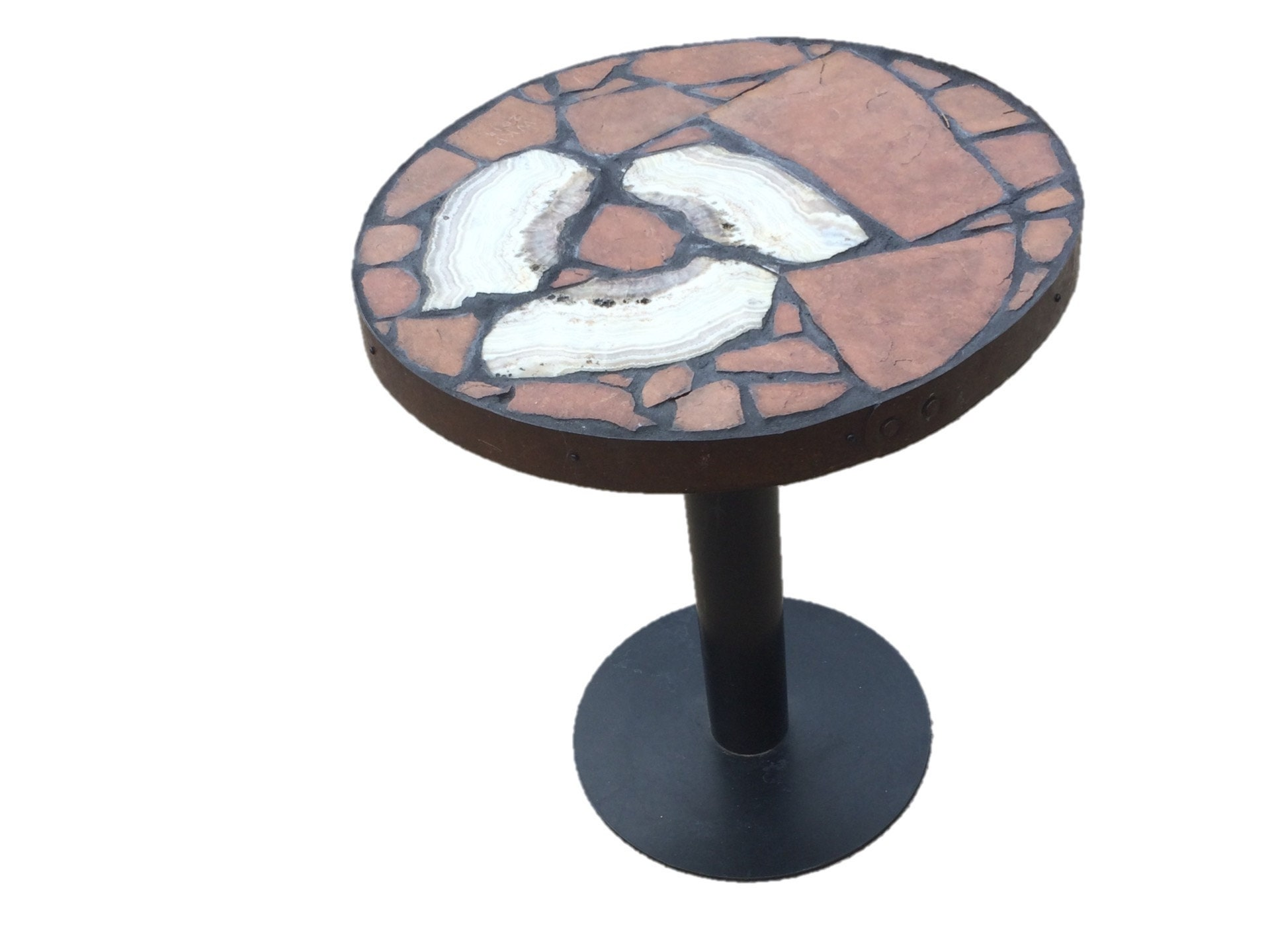 Creed Whirlpool: A small dining table featuring sowbelly agate