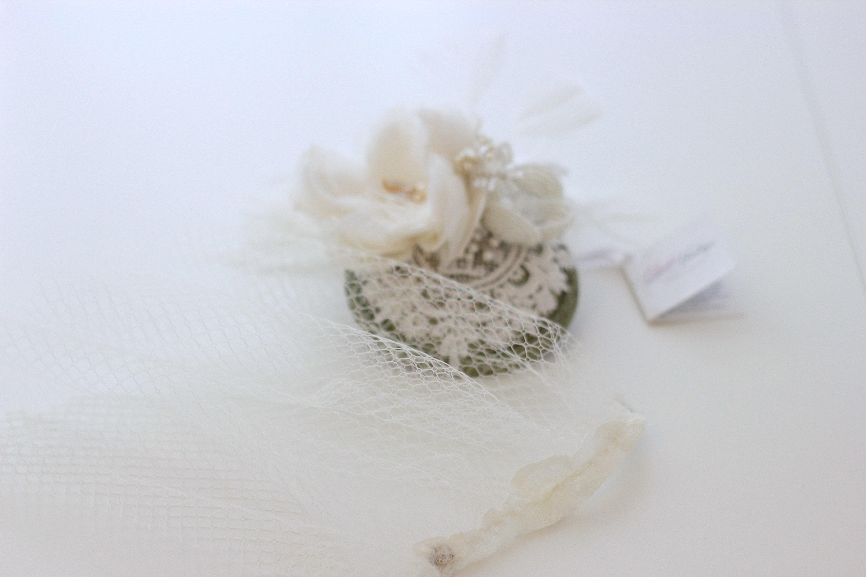 Versatile fascinator with removable birdcage veil, by Elizabete Munzlinger.