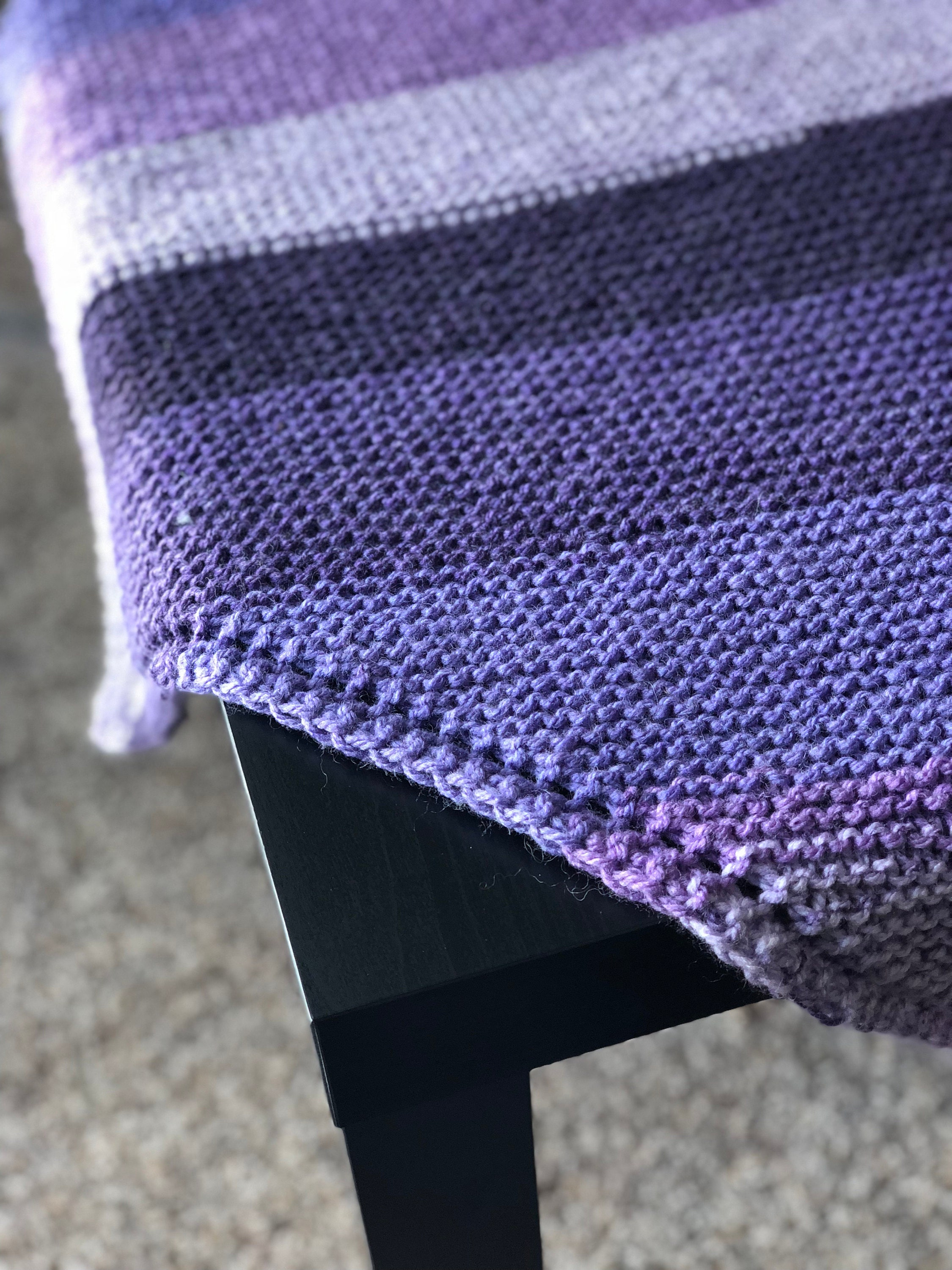 Purple shawl on a table