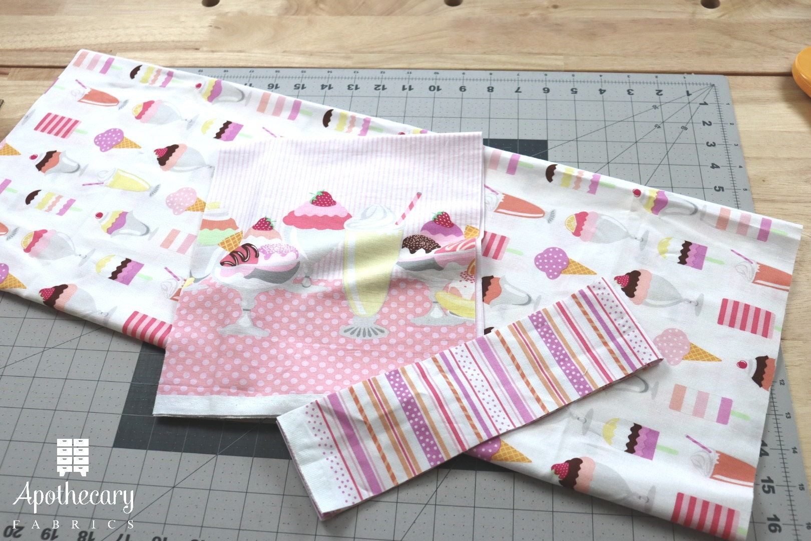 Three pieces of fabric cut to size for the Perfect Pillowcase tutorial.