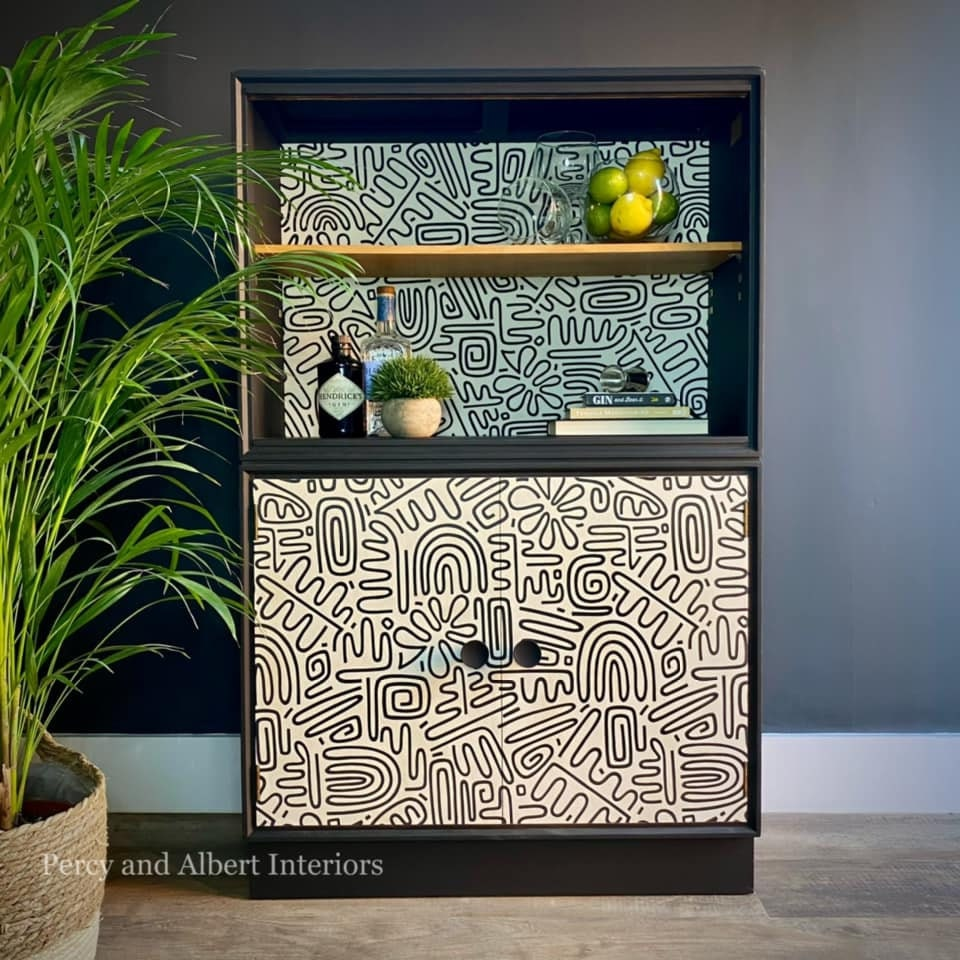 Black bookcase with graphic wallpaper