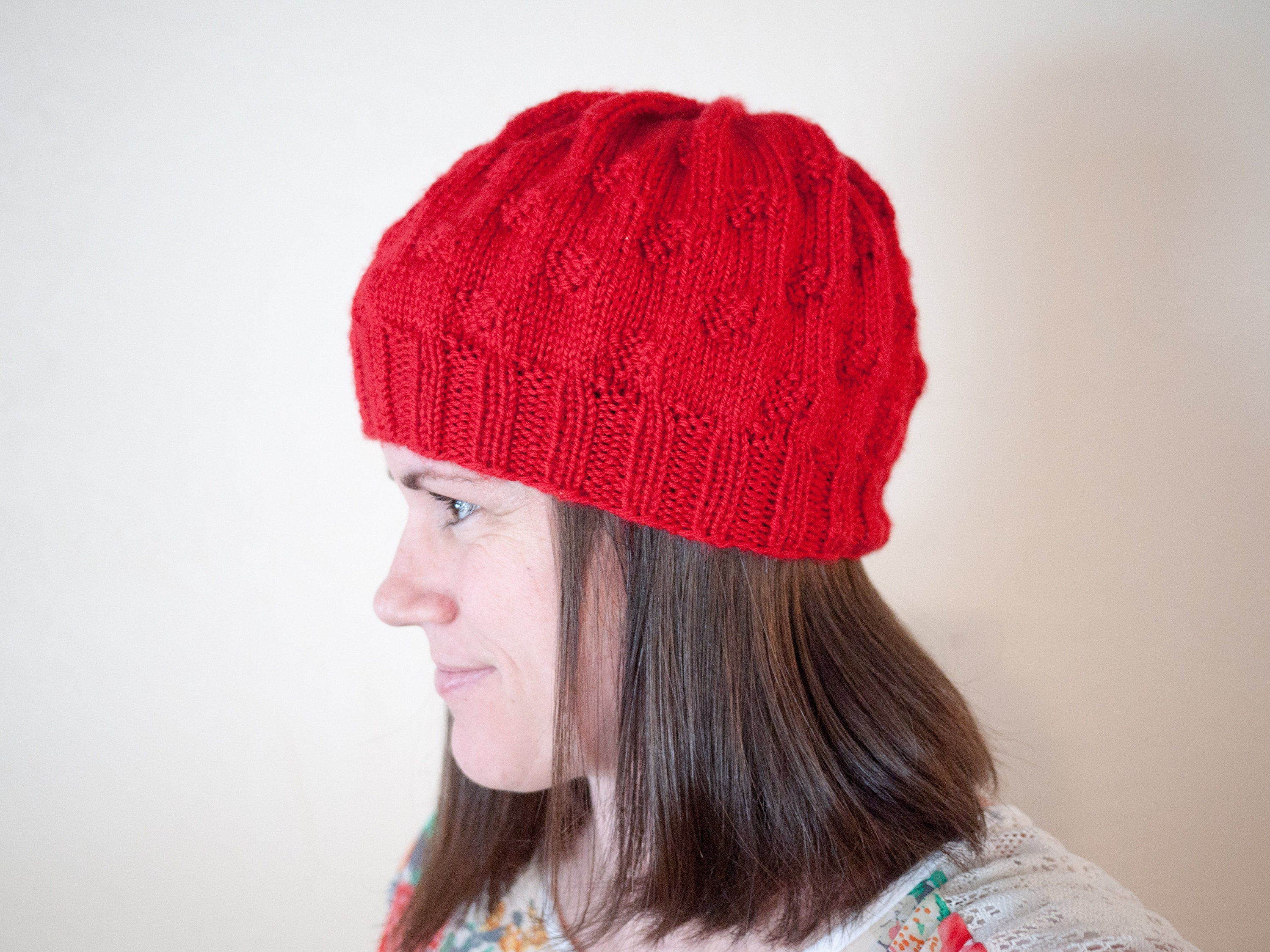 Side view of The Caitlin Hat in red.