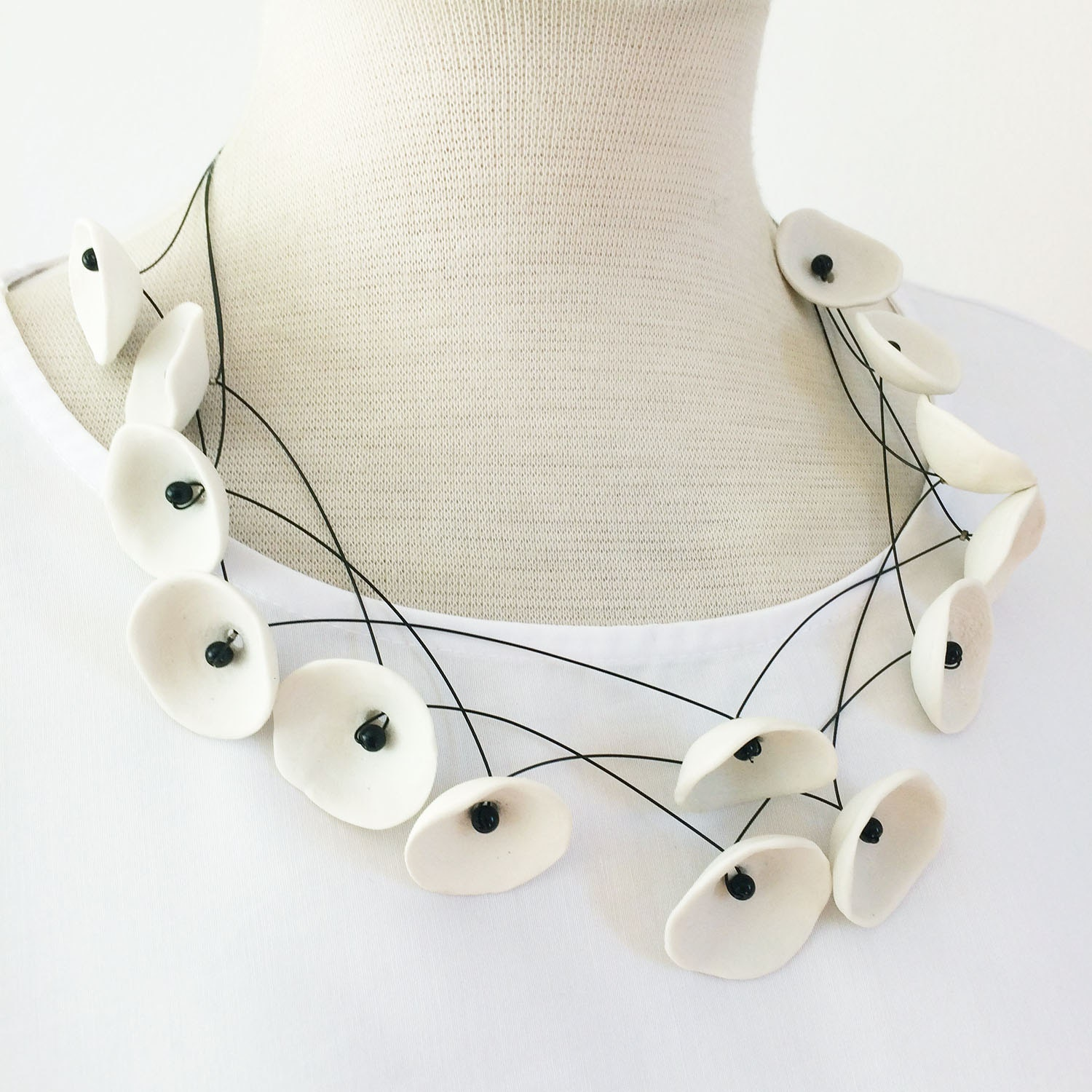 Porcelain nests necklace.