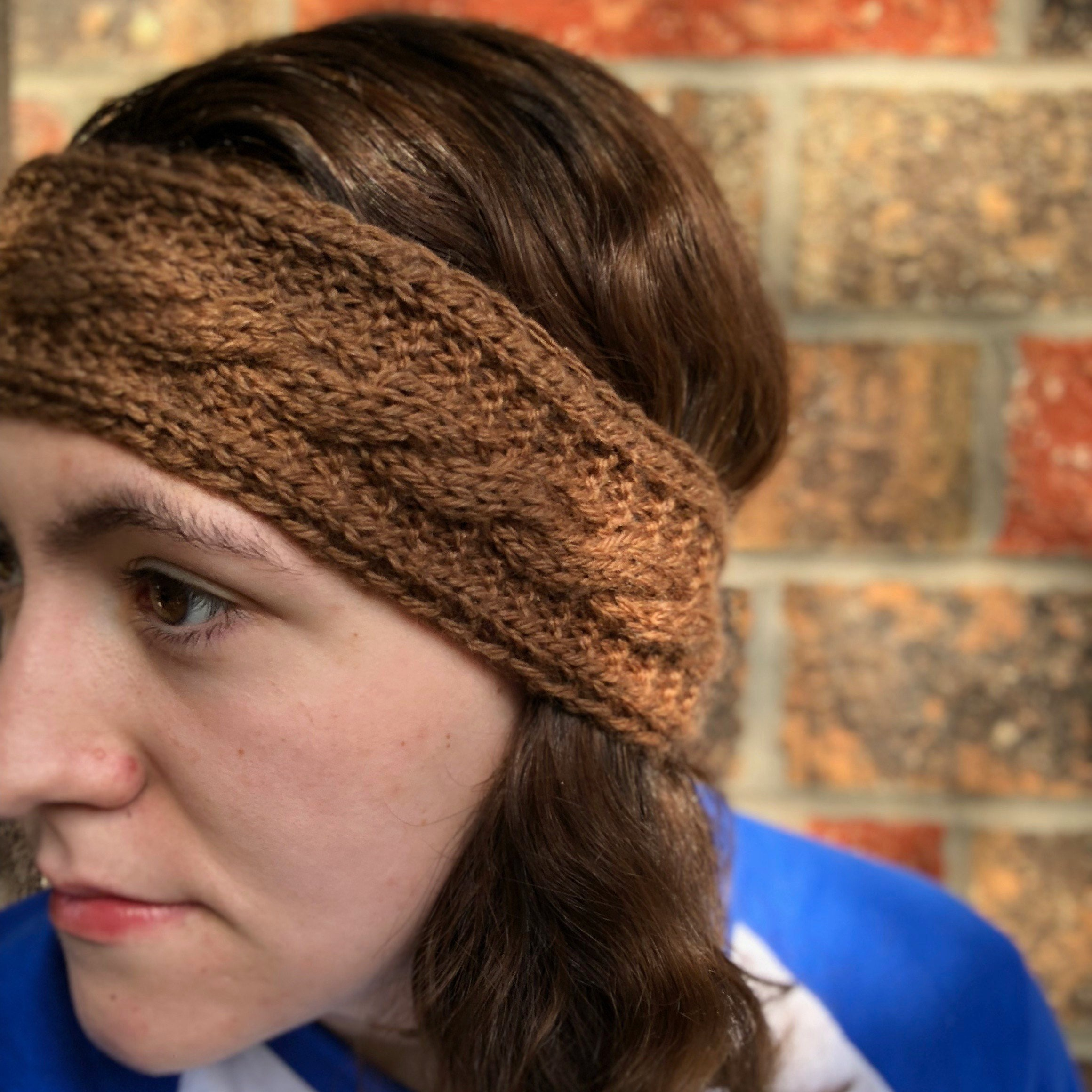 Woman wearing knitted headband