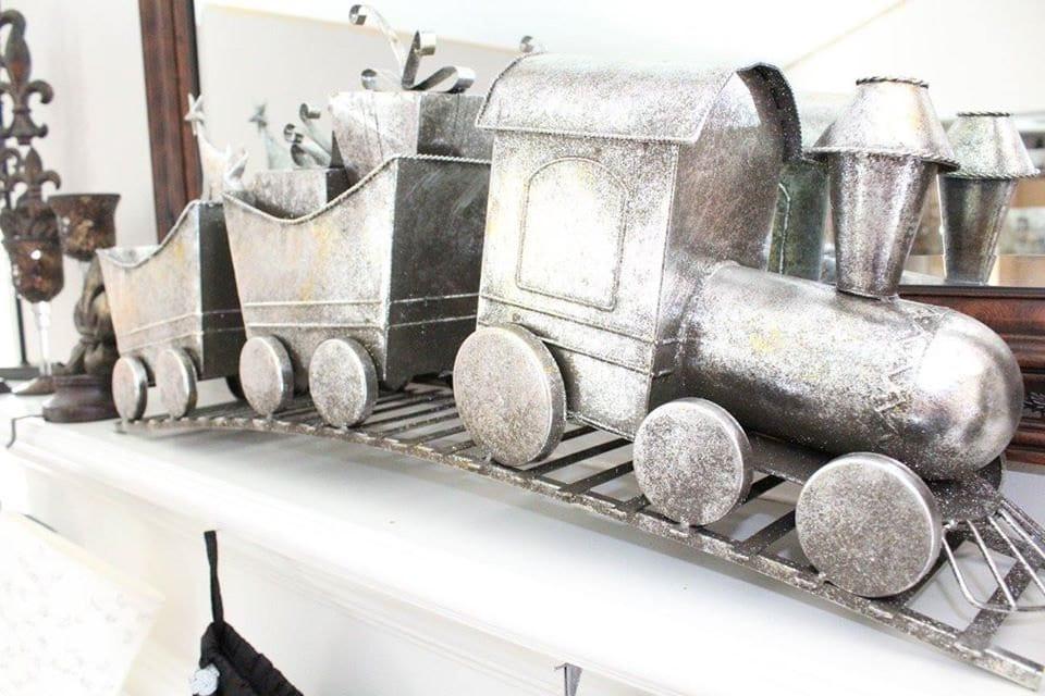 Christmas Train on white fireplace mantel.
