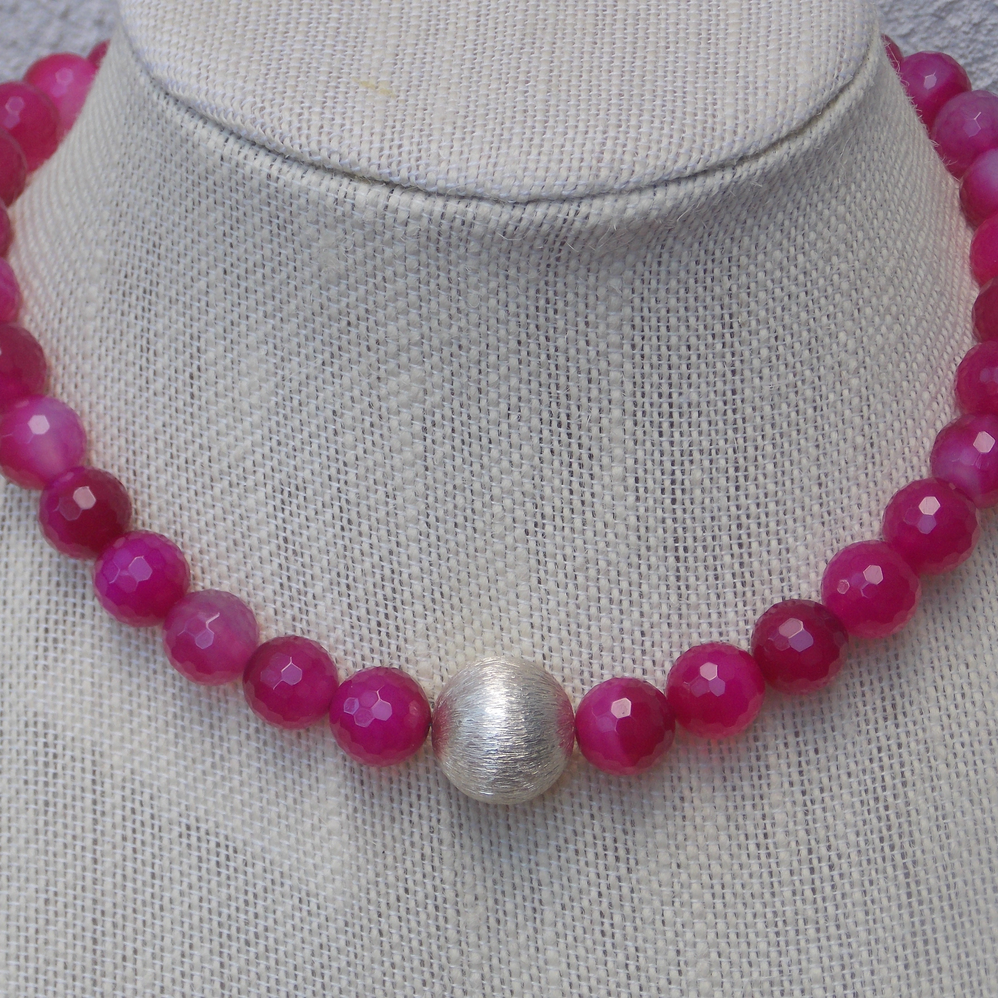 Simple but elegant coral and onyx with sterling silver clasp
