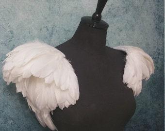 Feather shoulder pieces